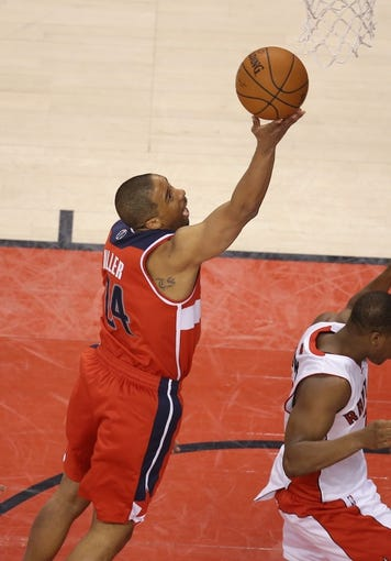 Feb 27, 2014; Toronto, Ontario, CAN; Washington Wizards guard Andre Miller (24) goes up to the basket against the Toronto Raptors at Air Canada Centre. The Wizards beat the Raptors 134-129 in triple overtime. Mandatory Credit: Tom Szczerbowski-USA TODAY Sports