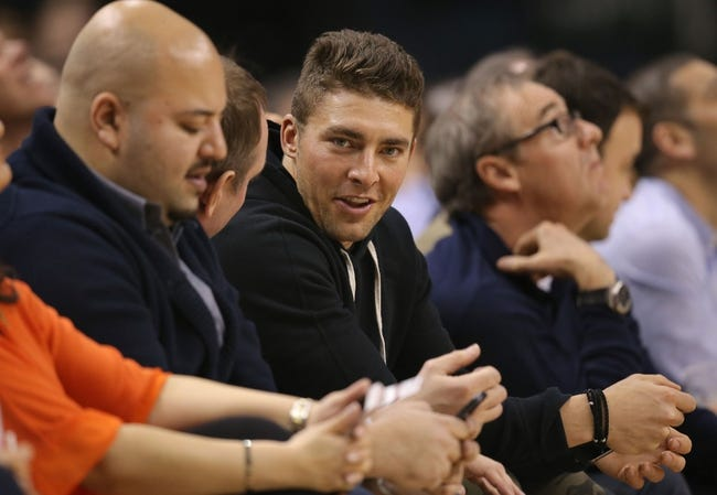 Mar 2, 2014; Toronto, Ontario, CAN; Toronto Maple Leafs forward Joffrey Lupul (19) watches the Toronto Raptors game against the Golden State Warriors at Air Canada Centre. The Raptors beat the Warriors 104-98. Mandatory Credit: Tom Szczerbowski-USA TODAY Sports