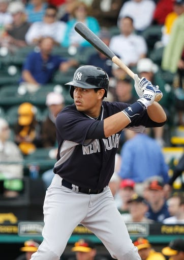 Feb 26, 2014; Bradenton, FL, USA; New York Yankees left fielder Ramon Flores (81) at bat against the Pittsburgh Pirates at McKechnie Field. Mandatory Credit: Kim Klement-USA TODAY Sports