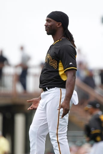 Feb 26, 2014; Bradenton, FL, USA; Pittsburgh Pirates center fielder Andrew McCutchen (22) reacts against the New York Yankees at McKechnie Field. Mandatory Credit: Kim Klement-USA TODAY Sports