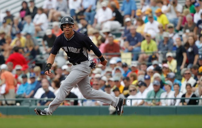Feb 26, 2014; Bradenton, FL, USA; New York Yankees center fielder Jacoby Ellsbury (22) leads off against the Pittsburgh Pirates at McKechnie Field. Mandatory Credit: Kim Klement-USA TODAY Sports
