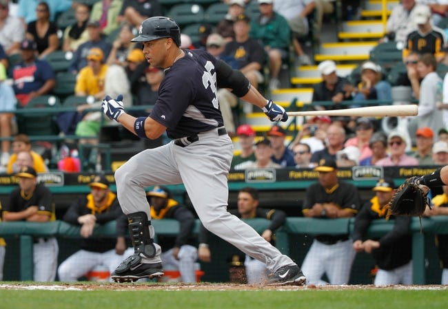 Feb 26, 2014; Bradenton, FL, USA; New York Yankees right fielder Carlos Beltran (36) at bat against the Pittsburgh Pirates at McKechnie Field. Mandatory Credit: Kim Klement-USA TODAY Sports
