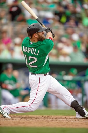 Mar 17, 2014; Fort Myers, FL, USA; Boston Red Sox first baseman Mike Napoli (12) grounds out during the seventh inning against the St. Louis Cardinals at JetBlue Park. The Boston Red Sox defeated the St. Louis Cardinals 10-5. Mandatory Credit: Jerome Miron-USA TODAY Sports