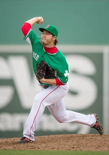 Mar 17, 2014; Fort Myers, FL, USA; Boston Red Sox relief pitcher Junichi Tazawa (36) pitches against the St. Louis Cardinals during the ninth inning at JetBlue Park. The Boston Red Sox defeated the St. Louis Cardinals 10-5. Mandatory Credit: Jerome Miron-USA TODAY Sports