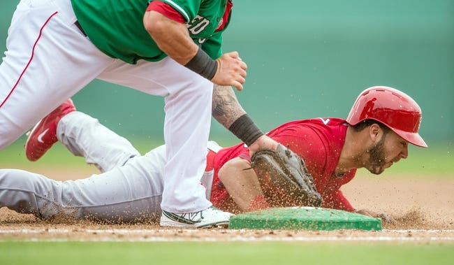 Mar 17, 2014; Fort Myers, FL, USA; St. Louis Cardinals catcher Tony Cruz (48) slides under the tag of Boston Red Sox first baseman Mike Napoli (12) during the third inning at JetBlue Park. The Boston Red Sox defeated the St. Louis Cardinals 10-5. Mandatory Credit: Jerome Miron-USA TODAY Sports