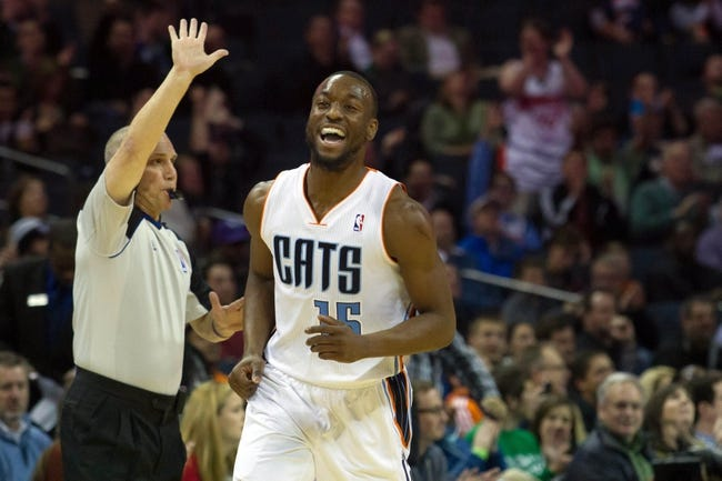 Mar 17, 2014; Charlotte, NC, USA; Charlotte Bobcats guard Kemba Walker (15) reacts after hitting a three point shot during the first half against the Atlanta Hawks at Time Warner Cable Arena. Mandatory Credit: Jeremy Brevard-USA TODAY Sports