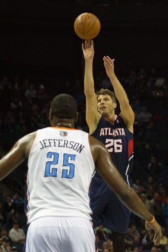 Mar 17, 2014; Charlotte, NC, USA; Atlanta Hawks guard Kyle Korver (26) shoots a three point shot during the first half against the Charlotte Bobcats at Time Warner Cable Arena. Mandatory Credit: Jeremy Brevard-USA TODAY Sports