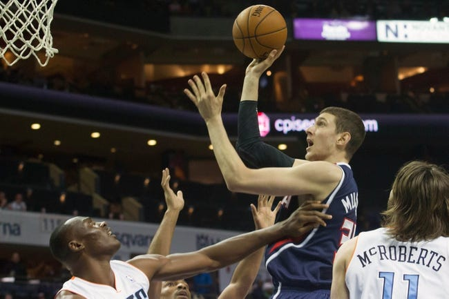 Mar 17, 2014; Charlotte, NC, USA; Atlanta Hawks center Mike Muscala (31) goes up for a shot over Charlotte Bobcats center Bismack Biyombo (0) during the first half at Time Warner Cable Arena. Mandatory Credit: Jeremy Brevard-USA TODAY Sports