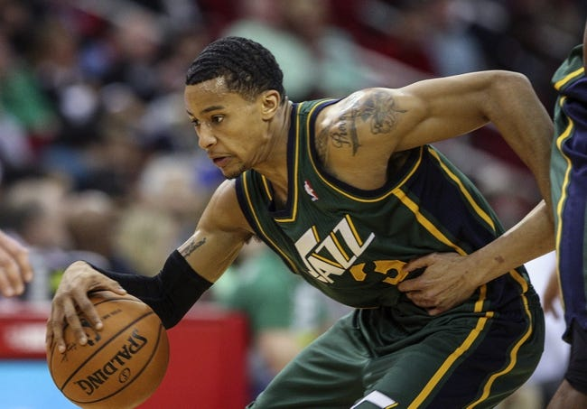 Mar 17, 2014; Houston, TX, USA; Utah Jazz guard Trey Burke (3) controls the ball during the first quarter against the Houston Rockets at Toyota Center. Mandatory Credit: Troy Taormina-USA TODAY Sports