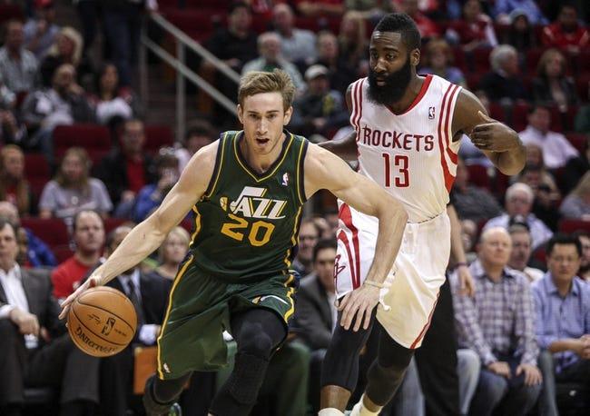 Mar 17, 2014; Houston, TX, USA; Utah Jazz guard Gordon Hayward (20) drives the ball as Houston Rockets guard James Harden (13) defends during the first quarter at Toyota Center. Mandatory Credit: Troy Taormina-USA TODAY Sports
