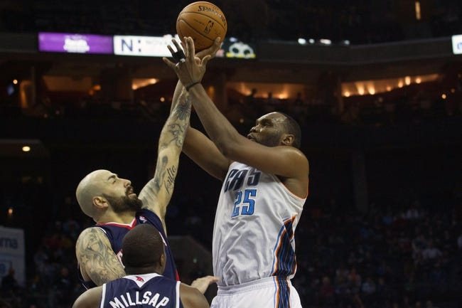 Mar 17, 2014; Charlotte, NC, USA; Charlotte Bobcats center Al Jefferson (25) shoots the ball over Atlanta Hawks center Pero Antic (6) during the second half at Time Warner Cable Arena. Atlanta defeated Charlotte 97-83. Mandatory Credit: Jeremy Brevard-USA TODAY Sports