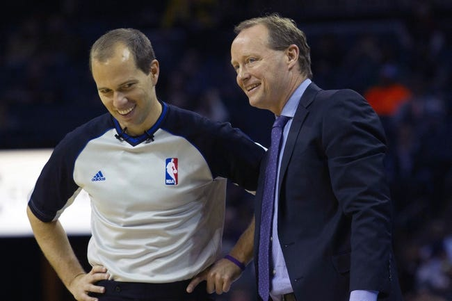 Mar 17, 2014; Charlotte, NC, USA; Atlanta Hawks head coach Mike Budenholzer talks with an official during the second half against the Charlotte Bobcats at Time Warner Cable Arena. Atlanta defeated Charlotte 97-83. Mandatory Credit: Jeremy Brevard-USA TODAY Sports