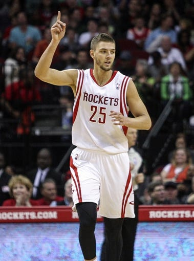 Mar 17, 2014; Houston, TX, USA; Houston Rockets forward Chandler Parsons (25) reacts after scoring a basket during the second quarter against the Utah Jazz at Toyota Center. Mandatory Credit: Troy Taormina-USA TODAY Sports