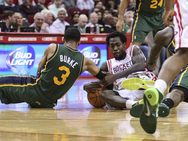Mar 17, 2014; Houston, TX, USA; Utah Jazz guard Trey Burke (3) and Houston Rockets guard Patrick Beverley (2) battle for the ball during the second quarter at Toyota Center. Mandatory Credit: Troy Taormina-USA TODAY Sports