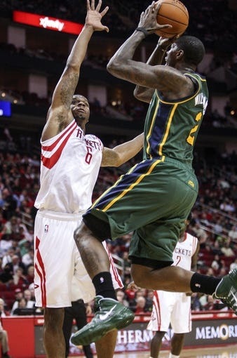 Mar 17, 2014; Houston, TX, USA; Utah Jazz forward Marvin Williams (2) shoots during the second quarter as Houston Rockets forward Terrence Jones (6) defends at Toyota Center. Mandatory Credit: Troy Taormina-USA TODAY Sports