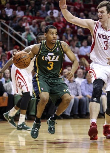 Mar 17, 2014; Houston, TX, USA; Utah Jazz guard Trey Burke (3) controls the ball during the second quarter against the Houston Rockets at Toyota Center. Mandatory Credit: Troy Taormina-USA TODAY Sports