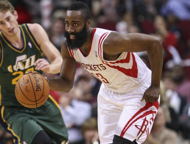 Mar 17, 2014; Houston, TX, USA; Houston Rockets guard James Harden (13) brings the ball up the court during the third quarter against the Utah Jazz at Toyota Center. Mandatory Credit: Troy Taormina-USA TODAY Sports