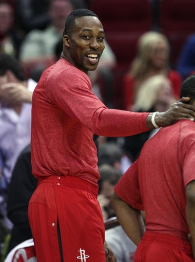 Mar 17, 2014; Houston, TX, USA; Houston Rockets center Dwight Howard (12) stands on the sideline during the third quarter against the Utah Jazz at Toyota Center. Mandatory Credit: Troy Taormina-USA TODAY Sports