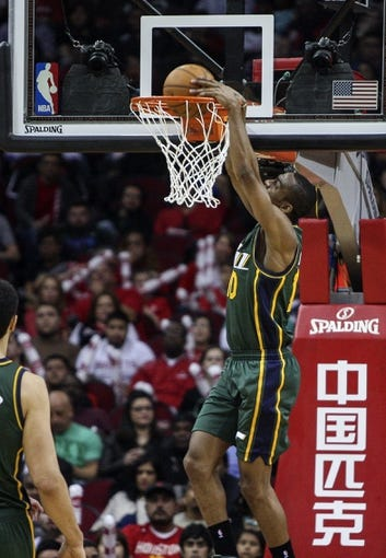 Mar 17, 2014; Houston, TX, USA; Utah Jazz guard Alec Burks (10) dunks the ball during the third quarter against the Houston Rockets at Toyota Center. The Rockets defeated the Jazz 124-86. Mandatory Credit: Troy Taormina-USA TODAY Sports