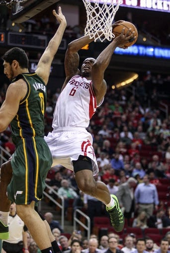 Mar 17, 2014; Houston, TX, USA; Houston Rockets forward Terrence Jones (6) takes the ball to the basket during the third quarter against the Utah Jazz at Toyota Center. The Rockets defeated the Jazz 124-86. Mandatory Credit: Troy Taormina-USA TODAY Sports