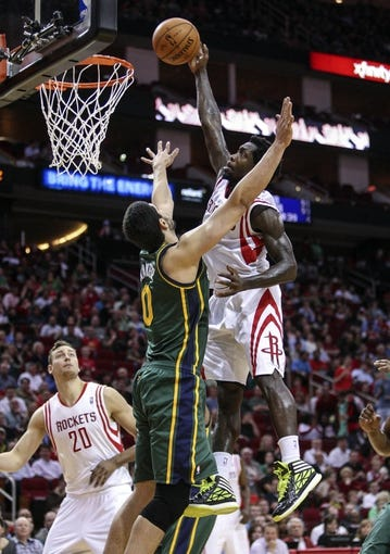 Mar 17, 2014; Houston, TX, USA; Houston Rockets guard Patrick Beverley (2) attempts to dunk the ball during the third quarter as Utah Jazz center Enes Kanter (0) defends at Toyota Center. The Rockets defeated the Jazz 124-86. Mandatory Credit: Troy Taormina-USA TODAY Sports