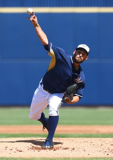 Mar 18, 2014; Phoenix, AZ, USA; Milwaukee Brewers pitcher Marco Estrada throws in the first inning against the Texas Rangers at Maryvale Baseball Park. Mandatory Credit: Mark J. Rebilas-USA TODAY Sports