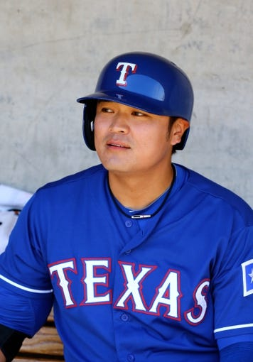 Mar 18, 2014; Phoenix, AZ, USA; Texas Rangers outfielder Shin-Soo Choo in the dugout against the Milwaukee Brewers at Maryvale Baseball Park. Mandatory Credit: Mark J. Rebilas-USA TODAY Sports