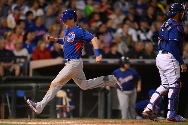 Mar 18, 2014; Surprise, AZ, USA; Chicago Cubs left fielder Chris Coghlan (28) scores a run against the Texas Rangers at Surprise Stadium. Mandatory Credit: Joe Camporeale-USA TODAY Sports