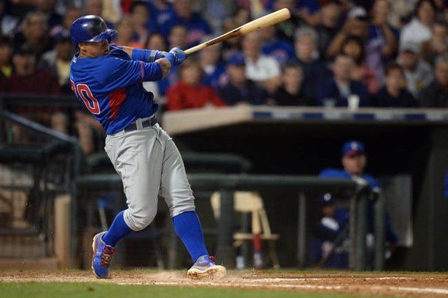 Mar 18, 2014; Surprise, AZ, USA; Chicago Cubs shortstop Javier Baez (70) follows through on a swing against the Texas Rangers at Surprise Stadium. Mandatory Credit: Joe Camporeale-USA TODAY Sports