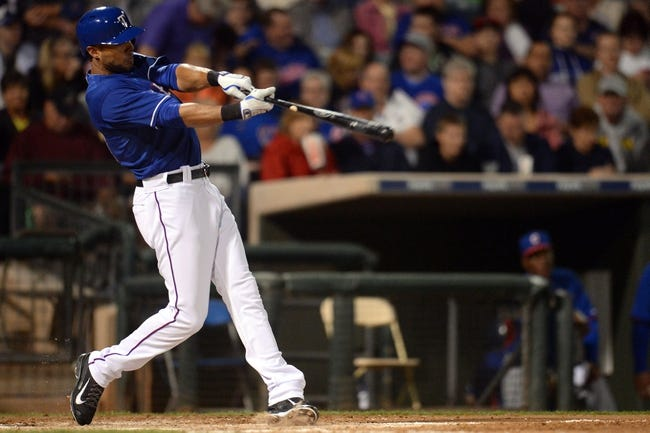 Mar 18, 2014; Surprise, AZ, USA; Texas Rangers right fielder Alex Rios (51) follows through on a swing in the fourth inning against the Chicago Cubs at Surprise Stadium. Mandatory Credit: Joe Camporeale-USA TODAY Sports