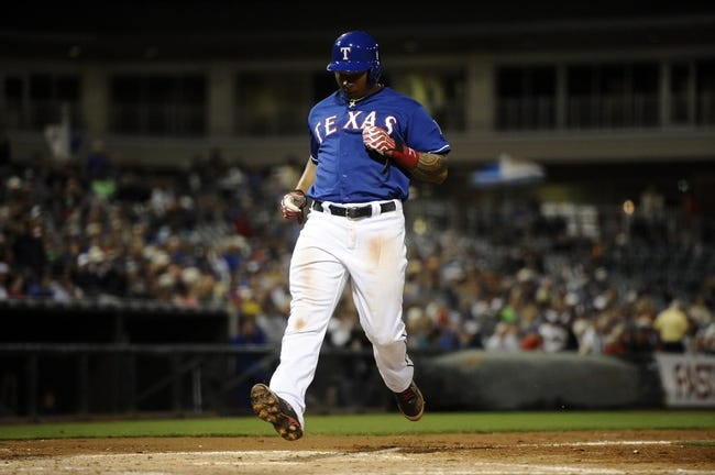 Mar 18, 2014; Surprise, AZ, USA; Texas Rangers center fielder Michael Choice (15) scores a run against the Chicago Cubs at Surprise Stadium. Mandatory Credit: Joe Camporeale-USA TODAY Sports