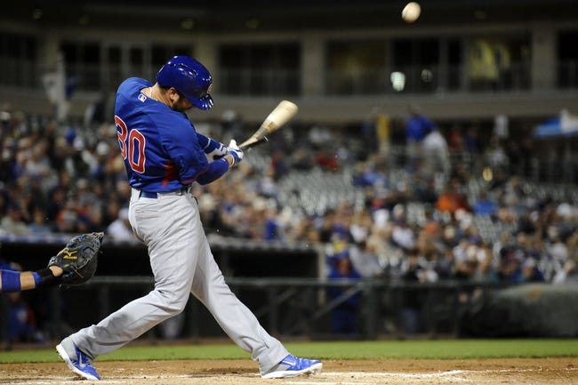 Mar 18, 2014; Surprise, AZ, USA; Chicago Cubs first baseman Mike Olt (30) breaks his bat on a swing against the Texas Rangers at Surprise Stadium. Mandatory Credit: Joe Camporeale-USA TODAY Sports