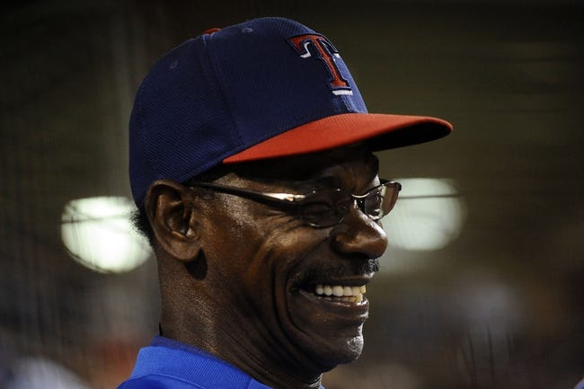 Mar 18, 2014; Surprise, AZ, USA; Texas Rangers manager Ron Washington looks on against the Chicago Cubs at Surprise Stadium. Mandatory Credit: Joe Camporeale-USA TODAY Sports