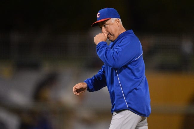 Mar 18, 2014; Surprise, AZ, USA; Chicago Cubs manager Rick Renteria (16) walks to the dugout against the Texas Rangers in the eighth inning at Surprise Stadium. Mandatory Credit: Joe Camporeale-USA TODAY Sports