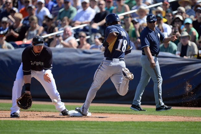 Mar 19, 2014; Peoria, AZ, USA; Milwaukee Brewers left fielder Khris Davis (18) beats out an infield bunt single against the Seattle Mariners in the first inning at Peoria Sports Complex. Mandatory Credit: Joe Camporeale-USA TODAY Sports
