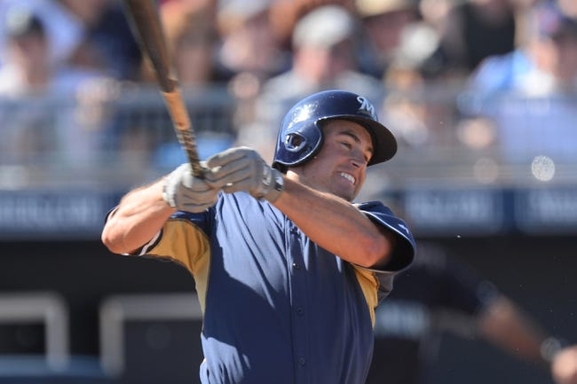 Mar 19, 2014; Peoria, AZ, USA; Milwaukee Brewers left fielder Logan Schafer (1) hits a single in the seventh inning against the Seattle Mariners at Peoria Sports Complex. The Brewers won 9-7. Mandatory Credit: Joe Camporeale-USA TODAY Sports