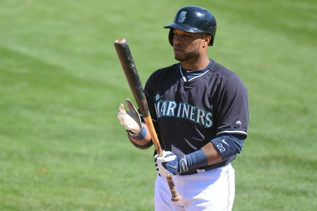 Mar 19, 2014; Peoria, AZ, USA; Seattle Mariners second baseman Robinson Cano (22) bats against the Milwaukee Brewers at Peoria Sports Complex. The Brewers won 9-7. Mandatory Credit: Joe Camporeale-USA TODAY Sports