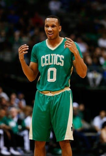 Mar 17, 2014; Dallas, TX, USA; Boston Celtics guard Avery Bradley (0) reacts during the game against the Dallas Mavericks at American Airlines Center. Dallas won 94-89. Mandatory Credit: Kevin Jairaj-USA TODAY Sports