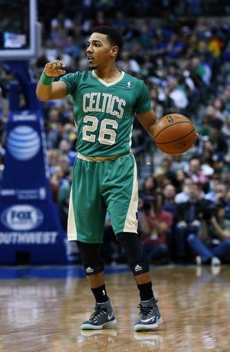 Mar 17, 2014; Dallas, TX, USA; Boston Celtics guard Phil Pressey (26) dribbles during the game against the Dallas Mavericks at American Airlines Center. Dallas won 94-89. Mandatory Credit: Kevin Jairaj-USA TODAY Sports
