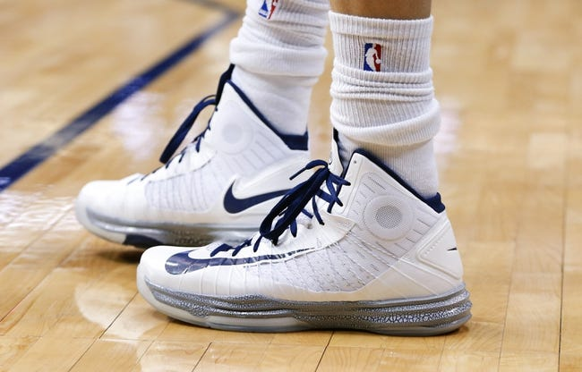Mar 17, 2014; Dallas, TX, USA; The shoes of Dallas Mavericks forward Dirk Nowitzki (41) during the game against the Boston Celtics at American Airlines Center. Dallas won 94-89. Mandatory Credit: Kevin Jairaj-USA TODAY Sports
