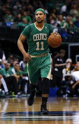 Mar 17, 2014; Dallas, TX, USA; Boston Celtics guard Jerryd Bayless (11) dribbles during the game against the Dallas Mavericks at American Airlines Center. Dallas won 94-89. Mandatory Credit: Kevin Jairaj-USA TODAY Sports