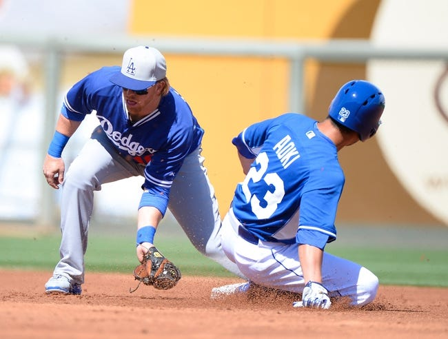 Mar 11, 2014; Surprise, AZ, USA; Kansas City Royals right fielder Norichika Aoki (23) steals second base ahead of the tag by Los Angeles Dodgers second baseman Justin Turner (10) during the first inning at Surprise Stadium. Mandatory Credit: Christopher Hanewinckel-USA TODAY Sports