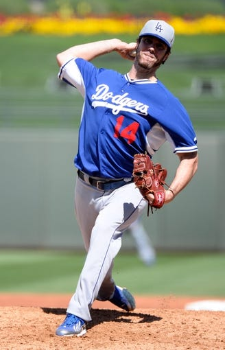 Mar 11, 2014; Surprise, AZ, USA;  Los Angeles Dodgers pitcher Dan Haren (14) throws during the third inning against the Kansas City Royals at Surprise Stadium. Mandatory Credit: Christopher Hanewinckel-USA TODAY Sports