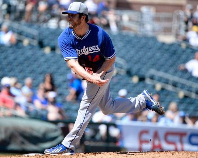 Mar 11, 2014; Surprise, AZ, USA; Los Angeles Dodgers pitcher Dan Haren (14) throws during the first inning against the Kansas City Royals at Surprise Stadium. Mandatory Credit: Christopher Hanewinckel-USA TODAY Sports