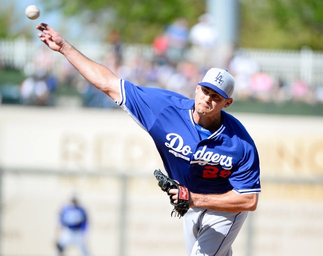 Mar 11, 2014; Surprise, AZ, USA;  Los Angeles Dodgers pitcher Jamey Wright (28) throws against the Kansas City Royals at Surprise Stadium. Mandatory Credit: Christopher Hanewinckel-USA TODAY Sports