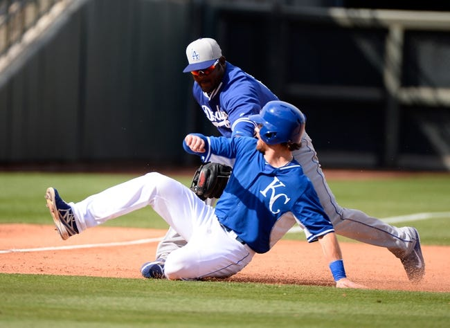 Mar 11, 2014; Surprise, AZ, USA;  Los Angeles Dodgers third baseman Juan Uribe (5) tags out Kansas City Royals infielder Jason Donald (45) during the sixth inning at Surprise Stadium. Mandatory Credit: Christopher Hanewinckel-USA TODAY Sports