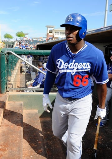 Mar 11, 2014; Surprise, AZ, USA;  Los Angeles Dodgers right fielder Yasiel Puig (66) before his at bat during the seventh inning against the Kansas City Royals at Surprise Stadium. Mandatory Credit: Christopher Hanewinckel-USA TODAY Sports