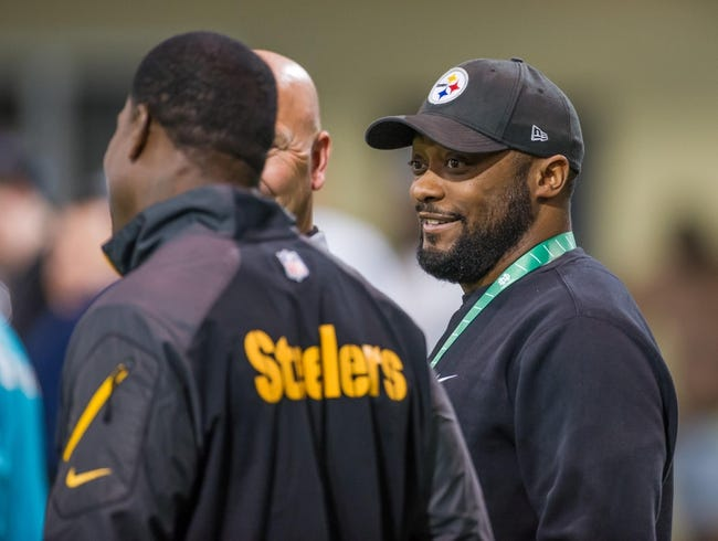Mar 20, 2014; Notre Dame, IN, USA; Pittsburgh Steelers head coach Mike Tomlin watches Notre Dame pro day at the Guglielmino Athletics Complex. Mandatory Credit: Matt Cashore-USA TODAY Sports