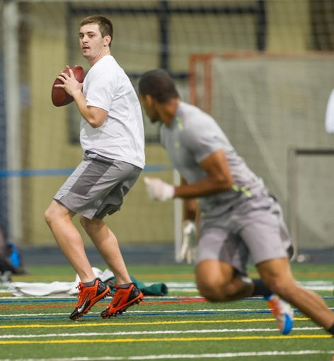 Mar 20, 2014; Notre Dame, IN, USA; Notre Dame Fighting Irish former football player Tommy Rees throws during Notre Dame pro day at the Guglielmino Athletics Complex. Mandatory Credit: Matt Cashore-USA TODAY Sports
