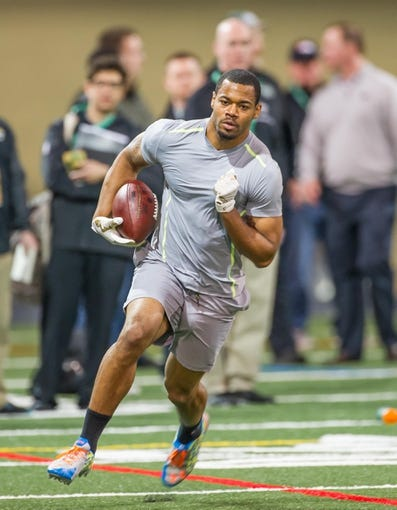 Mar 20, 2014; Notre Dame, IN, USA; Notre Dame Fighting Irish former football player George Atkinson III runs a drill during Notre Dame pro day at the Guglielmino Athletics Complex. Mandatory Credit: Matt Cashore-USA TODAY Sports